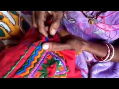 How to sew on a shisha mirror demonstrated here by Dhya in rural India.