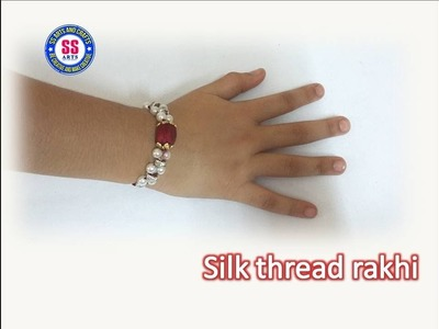 How to make silk thread rakhi for raksha bandhan.silk thread and pearls rakhi making at home