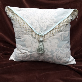 Beaded brocade cushion
