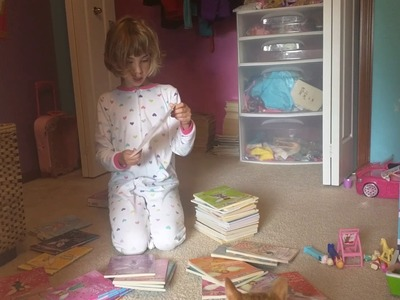 Olivia and her Rainbow Magic book collection!