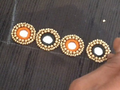 Georgeous neck design for saree blouse using mirrors and beads Embroidery