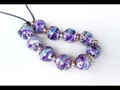 Swirl violet  lampwork glass beads 18 mm.