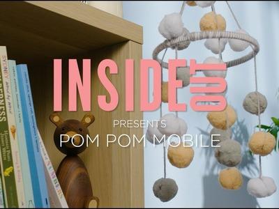 DIY Decorating: How to make a pom pom mobile