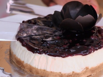 Learn how to make a simple delicious baked blueberry cheesecake using easily available ingredients