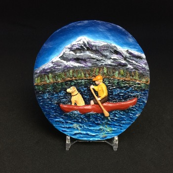 Young boy with his dog in a canoe ~ Handmade/Hand Painted Relief Sculpture