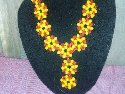 The tutorial on how to make this yellow and red necklace bead