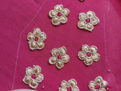 5 Petal Flower Aplic Embroidery being Embellished with small beads