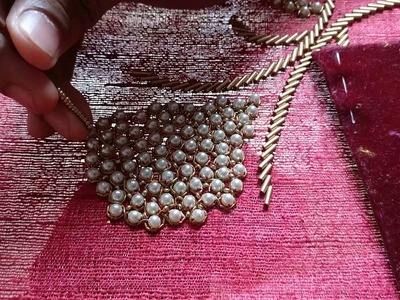 Placing sugar beads among big white pearls