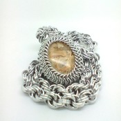 Yellow crazy agate cabochon on a spiral weave chainmaille/chainmail chain