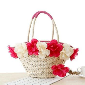 Woven petite handbag with decorative flowers