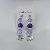 Crystal and bead dangle earrings with dog charm