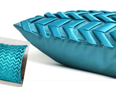 Luxury cushion cover with ribbon details.