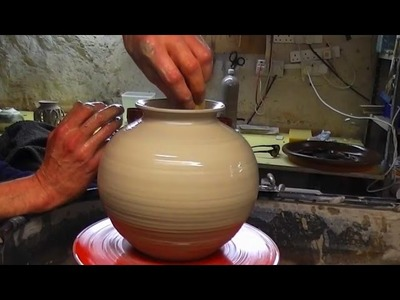 Throwing. Making a Round Pottery Vase on the Wheel
