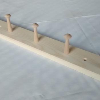 Handmade wooden coat rack with  5 shaker pegs.