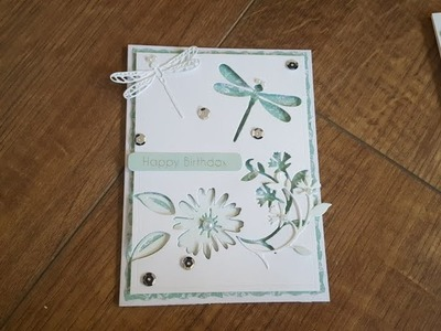 Handmade card using negative and positive space after dies cutting