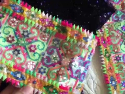 Hmong item of the day 21: Hmong outfit with paaj ntaub qwj and heart with sequins colorful triangle