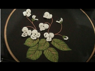 Hand embroidery beautiful jasmine flower with leaves