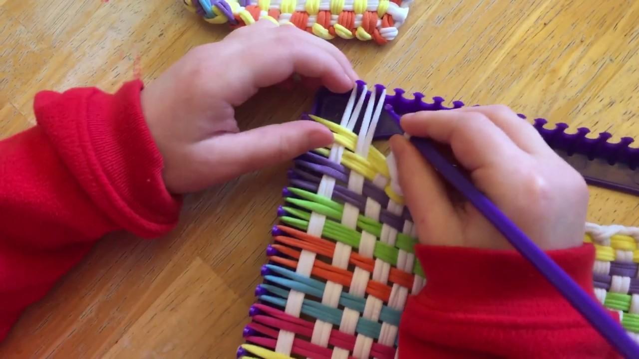 Finishing off kids weaving loom project