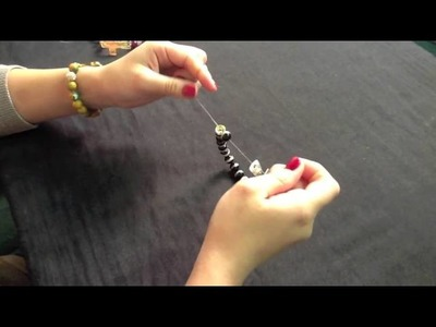 How to make stretchy cross bracelet with two loops.