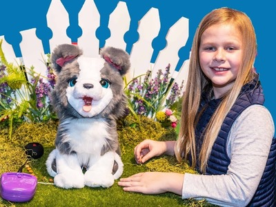 Assistant with Hatchimals Fun Furreal Pets and JoJo Siwa Jewelry at the Toy Fair