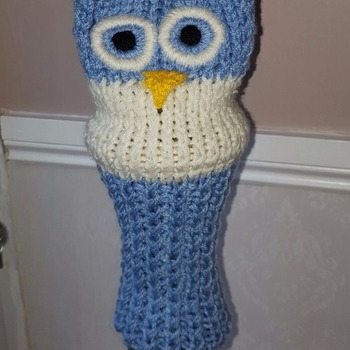 a beautifully hand knitted golf club head cover in owl design for a driver available in a selection of colours