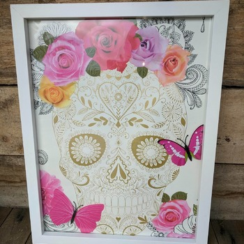 handcrafted white framed golden skull with roses and cerise butterflies