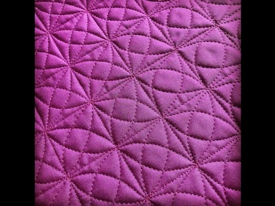 Kaleidoscope free-motion quilting in a grid!
