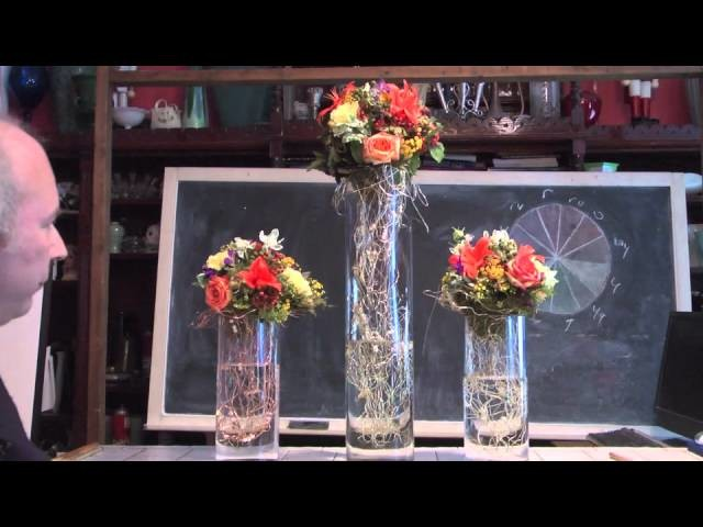 Party Floral Art on Glass Columns With Wire Collars and Foam Spheres