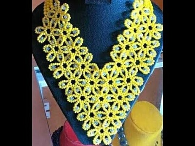 The tutorial on how to make this beautiful yellow and silver necklace bead.