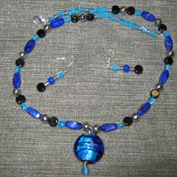 Large blue swirled pendant necklace