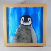 penguin made with fused glass,wood frame, goes by the name of 'RUBY' Handmade