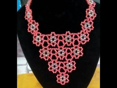 The tutorial on how to make this beautiful silver and red necklace bead