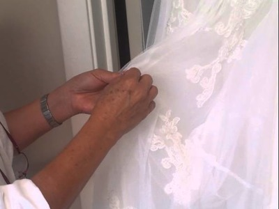 How an over or under bustle works on a bridal ballgown