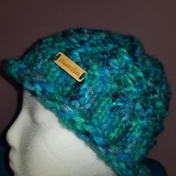 Funky chunky hat for an older child made of a blend of acrylic and nylon.