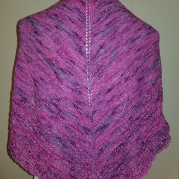 Knitted shawl in beautiful tones of pinks and purples using a blend of 50 percent baby alpaca and 50 percent merino wool. Gorgeous