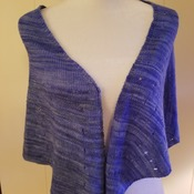 Lightweight knit shawl in a fingering weight merino wool using purple gradient to bring out the design. Gorgeous!
