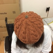 Brown Cable Hat with a paw button