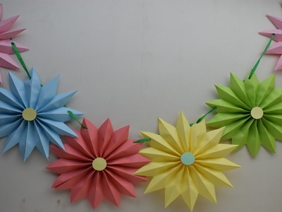 Christmas wall decor -  Diy paper Rosettes Garland for Christmas party Decoration on budget
