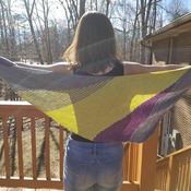 Gorgeous asymmetrical lightweight shawl made of a blend of merino wool, cashmere goat and nylon can be worn in a variety of ways.