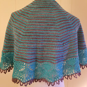 Lovely knit shawl made of fingering weight 90 percent fine Italian merino wool and 10 percent nylon in shades of teal and chocolate brown