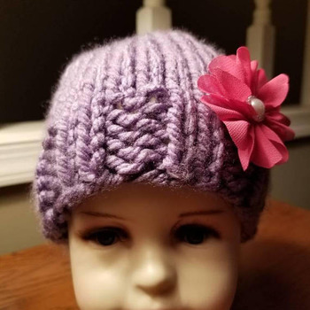 Baby/toddler hand knit hat with cute flower accent