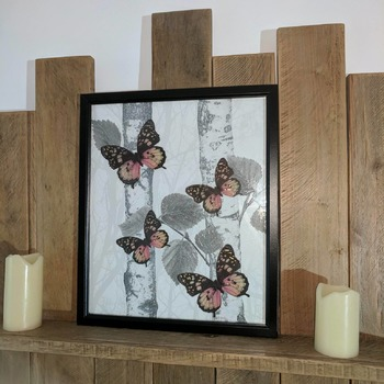 black framed handcrafted butterfly picture, silver trees, black pink and yellow butterflies