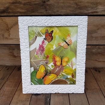 textured light weight framed orange butterfly picture with jungle background