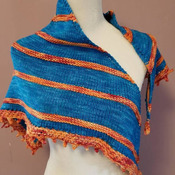 Bright and beautiful hand knit shawl of superwash merino wool