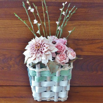 Handmade cold porcelain flower bouquet.dhalia and roses in wooden vase