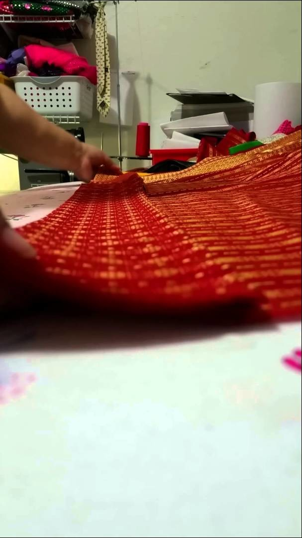 How I fold the front of the Thai skirt. .