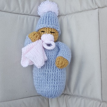 hand knitted baby doll