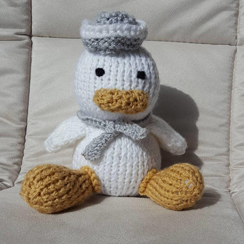 knitted baby sailor duck in white and silver grey