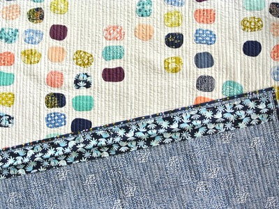 Quilting Tutorial: How to Sew a Sleeve to the Back of a Quilt