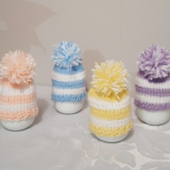 knitted set of 4 spring coloured stripe egg cosies